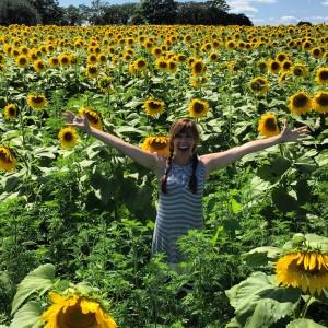 Kee Kee in sunflower field
